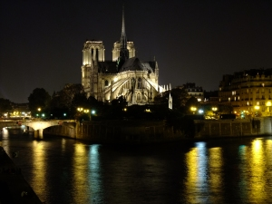 View of Notre Dame at night across the Seine